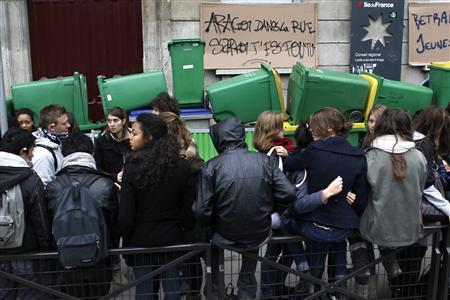 French high school students block the access of the Arago high school in Paris