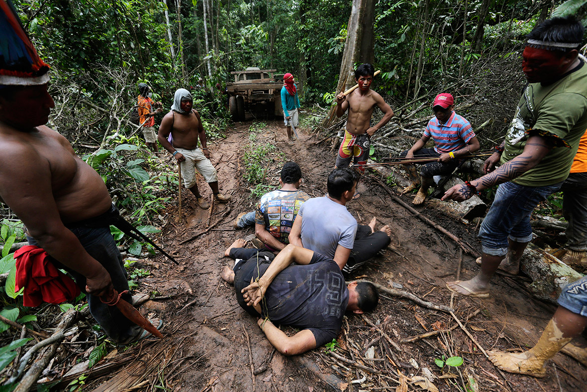 amazon-indians-strip-tie-beat-illegal-loggers