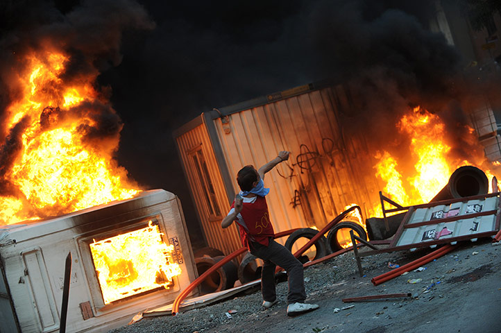 A protestor throws stones
