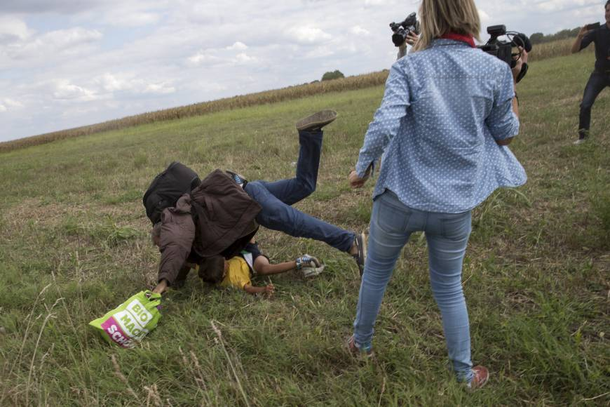 hungary camerawoman trips migrant