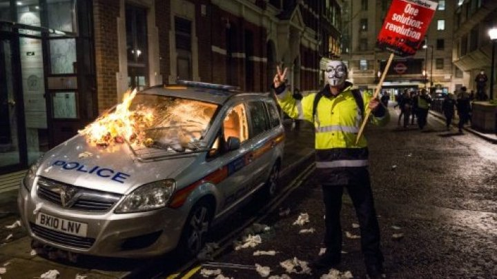 guy fawkes cop car burning london million march
