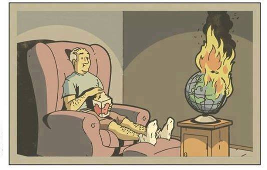man watching world burn like it was a tv
