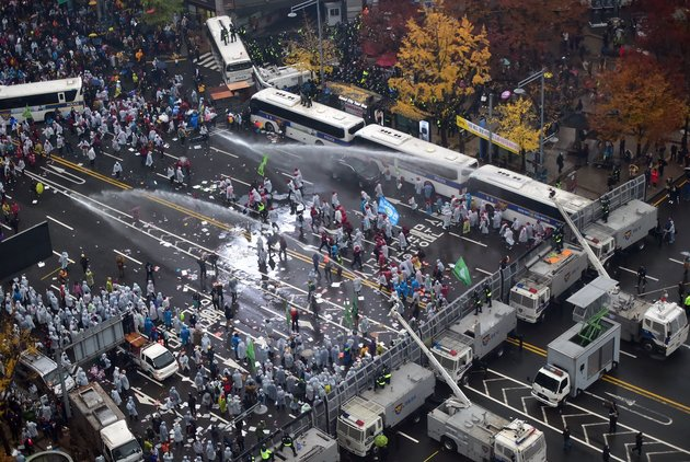 Police use water cannons to block South Korean protestors following a large rally against the government in downtown Seoul on November 14, 2015. Tens of thousands of people took to the street in central Seoul in a massive protest against the conservative government's drive for labour reform and state-issued history textbooks. AFP PHOTO / JUNG YEON-JE (Photo credit should read JUNG YEON-JE/AFP/Getty Images)