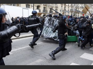 Youths clash with riot police officers during a high school students demonstration against a labor reform, in Paris, Thursday, March 24, 2016. France's Socialist government is due to formally present a contested labor reform that aims to amend the 35-hour workweek and relax other labor rules.(AP Photo/Francois Mori)/XFM101/636098245336/1603241425